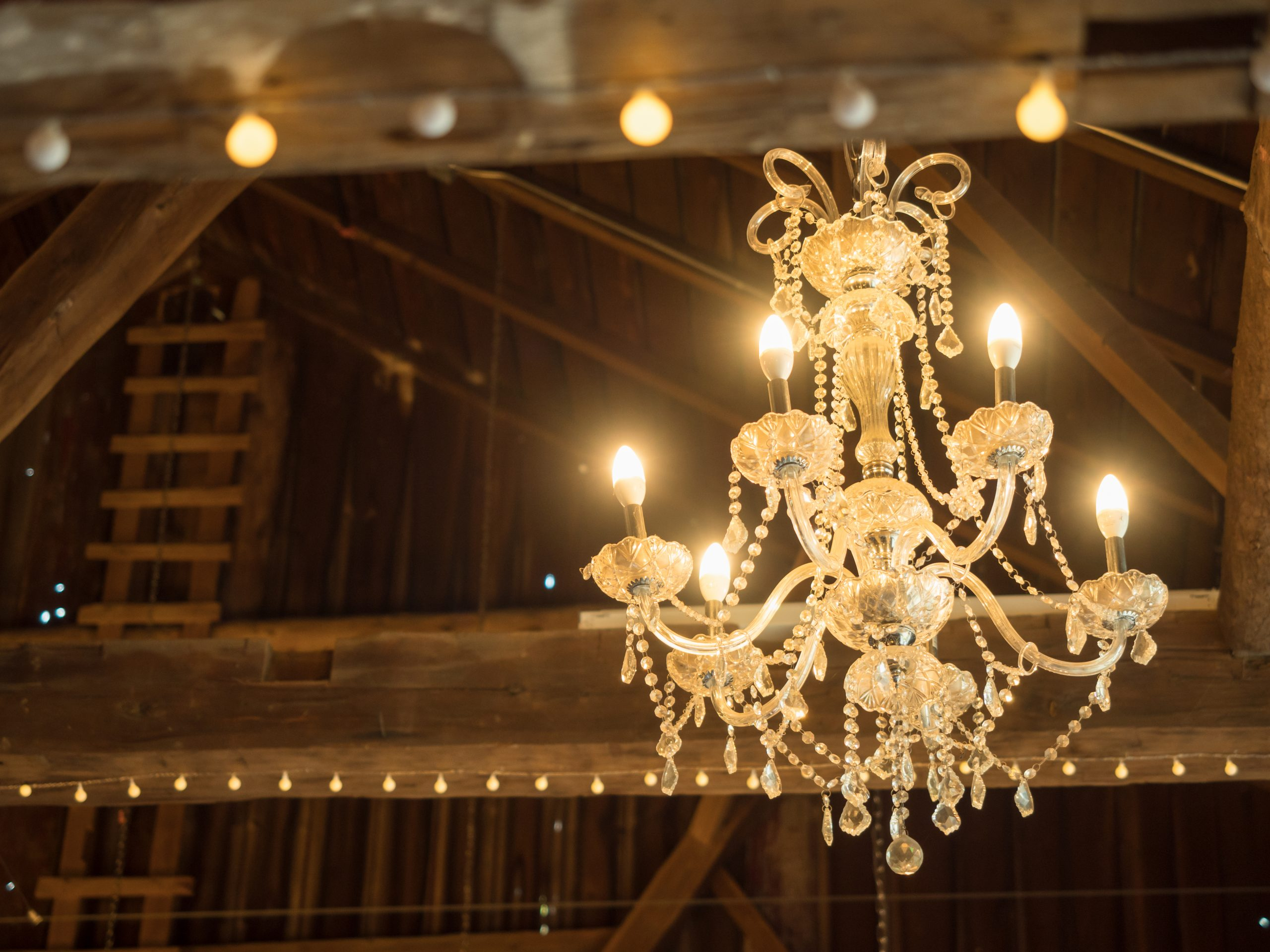 Chandelier in middle of Juliet Rome Lifestyle